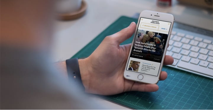 A user browsing the Independent Journal Review website on their mobile phone.