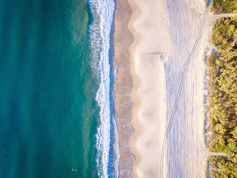 Aerial photograph of a beach and waves